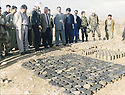 Iraq 2000 <br />  Left, Mamosta Rostam, In the middle, Mullazem Omar Abdallah,, Home Secretary in Suleimania, next to him, Hakim Kader, looking at mines collected in the district  <br /> Irak 2000 <br /> A gauche, , Mamosta Rostam, au milieu, Mullazem Omar Abdallah, ministre de l'Interieur a Suleimania, a cote, Hakim Kader, iinspectant des mines ramasseees dans la region