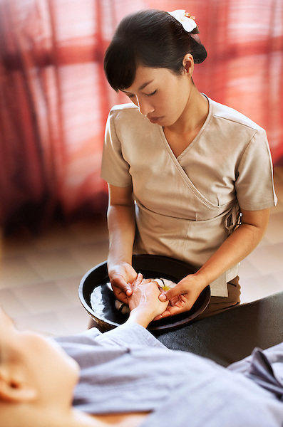 Woman receives spa manicure at Visaya Spa, FCC Angkor, Siem Reap, Cambodia. The manicure begins with a warm hand soak and massage, and ends with a polish application.