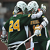 Andrew Lockhart #41 of Ward Melville, right, gets congratulated by teammate Connor Grippe #24 after scoring a goal to break a 7-7 tie in the fourth quarter of a non-league varsity boys lacrosse game against host Chaminade High School on Saturday, Apr. 2, 2016. Ward Melville held on to the lead from that point on and won by a score of 9-8.