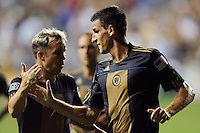 Sebastien Le Toux (9) of the Philadelphia Union celebrates scoring with teammate Eduardo Coudet (21). The Columbus Crew defeated the Philadelphia Union 2-1 during a Major League Soccer (MLS) match at PPL Park in Chester, PA, on August 05, 2010.