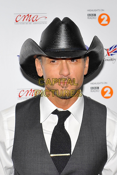 Tim McGraw.at Country2Country, O2 Arena, Greenwich, London, England, UK, .16th March 2013..country music  portrait headshot black cowboy hat grey waistcoat white shirt tie  beard facial hair .CAP/MAR.© Martin Harris/Capital Pictures.