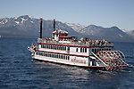 The M.S. Dixie II paddlewheel boat on Lake Tahoe during the Opening Day of Summer race with the Tahoe Queen