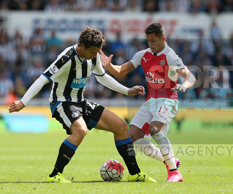 Daryl Janmaat of Newcastle United tackled by Alexis Sanchez of Arsenal - English Premier League - Newcastle Utd v Arsenal - St James' Park Stadium - Newcastle - England - 28th August 2015 - Picture Simon Bellis/Sportimage