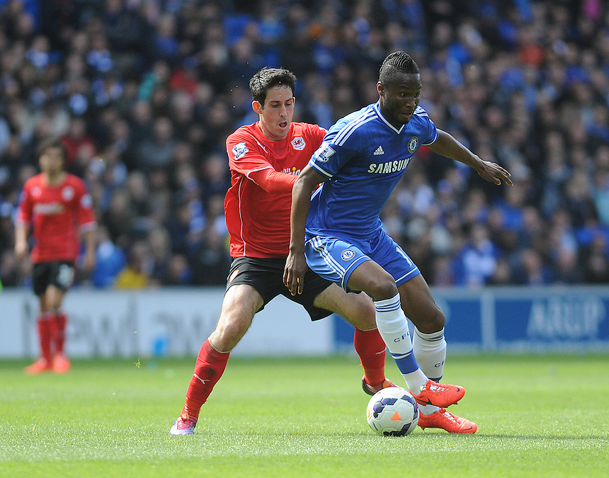 Cardiff City's Peter Whittingham vies for possession with Chelsea's  Mikel John Obi<br /> <br /> Photographer Ashley Crowden/CameraSport<br /> <br /> Football - Barclays Premiership - Cardiff City v Chelsea - Sunday 11th May 2014 - Cardifff City Stadium - Cardiff<br /> <br /> &copy; CameraSport - 43 Linden Ave. Countesthorpe. Leicester. England. LE8 5PG - Tel: +44 (0) 116 277 4147 - admin@camerasport.com - www.camerasport.com
