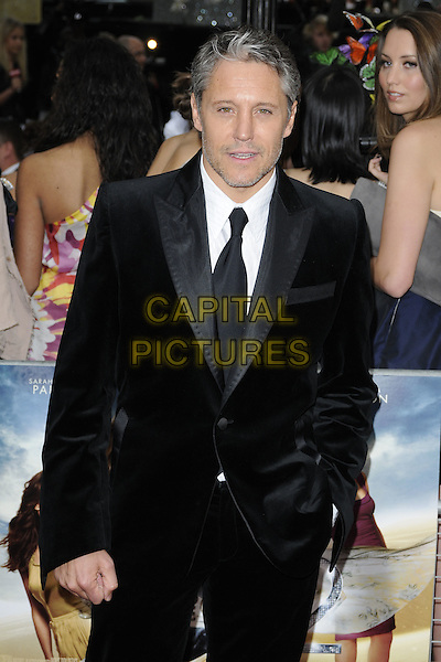 MARK RYAN.Attending the 'Sex And The City 2' European Film Premiere at the Odeon, Leicester Square, London, England, UK, May 27th, 2010 .arrivals half length black suit tie white shirt  hand in pocket velvet beard facial hair stubble .CAP/CAN.©Can Nguyen/Capital Pictures.
