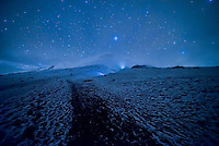 Stars above Cotopaxi Volcano at start of climb to 5,897m summit, Cotopaxi National Park, Cotopaxi Province, Ecuador