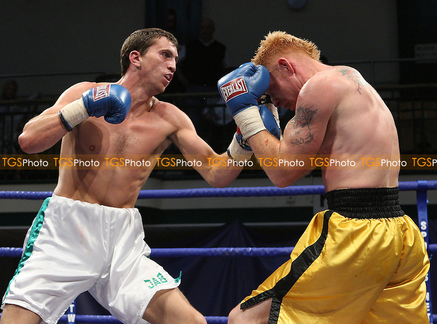 Eddie Corcoran (Wembley, white shorts) defeats David Wakefield (Tooting, yellow shorts) in a Welterweight contest at York Hall, Bethnal Green, promoted by Frank Warren, Sports Network - 14/06/08 - MANDATORY CREDIT: Gavin Ellis/TGSPHOTO. Self-Billing applies where appropriate. NO UNPAID USE. Tel: 0845 094 6026