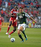 Chicago forward Dominic Oduro (8) and Portland defender David Horst (12) battle for the ball.  The Portland Timbers defeated the Chicago Fire 1-0 at Toyota Park in Bridgeview, IL on July 16, 2011.
