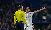 Marquinhos of Paris Saint-Germain complains to Referee Felix Brych (GER) during the UEFA Champions League Round of 16 2nd leg match between Chelsea and PSG at Stamford Bridge, London, England on 9 March 2016. Photo by Andy Rowland.