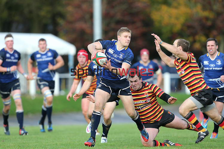Leinster centre Steve Crosbie looks for support as the Quins defence closes in.<br /> British &amp; Irish Cup<br /> Carmarthen Quins v Leinster A<br /> Carmarthen Park<br /> 25.10.14<br /> &copy;Steve Pope-SPORTINGWALES