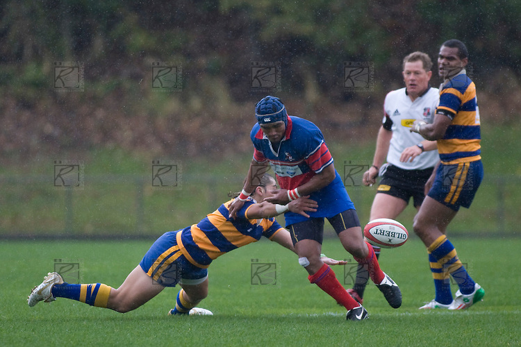 Alesio Petelo drops the ball as he is tackled by Tino Halalilo. CMRFU Counties Power 2008 Club rugby McNamara Cup Premier final between Ardmore Marist & Patumahoe played at Growers Stadium, Pukekohe on July 26th.  Ardmore Marist won 9 - 8.