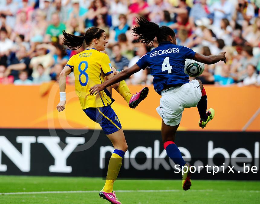 Fifa Women's World Cup Germany 2011 : Zweden - France Frankrijk at Sinsheim World Cup stadium : duel tussen Lotta Schelin en Laura Georges.foto DAVID CATRY / Vrouwenteam.be