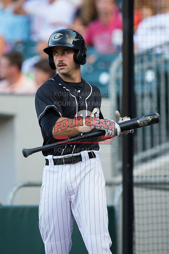 Ethan Wilson (12) of the Charlotte Knights waits for his turn to bat during the game against the Gwinnett Braves at BB&T BallPark on August 11, 2015 in Charlotte, North Carolina.  The Knights defeated the Braves 3-2.  (Brian Westerholt/Four Seam Images)