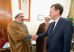 Peter Prove (right) director of international affairs for the World Council of Churches, greets Yusef El-Nasar, a Shia Muslim leader, during the visit of an international ecumenical delegation to Baghdad, Iraq, on January 21, 2017. The encounter took place at St Gregory the Illuminator Armenian Orthodox Church.