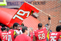 College Park, MD - SEPT 22, 2018: Maryland Terrapins offensive lineman Ellis McKennie (68) waves a flag representing fallen teammate Jordan McNair after game between Maryland and Minnesota at Capital One Field at Maryland Stadium in College Park, MD. The Terrapins defeated the Golden Bears 42-13 to move to 3-1 on the season. (Photo by Phil Peters/Media Images International)