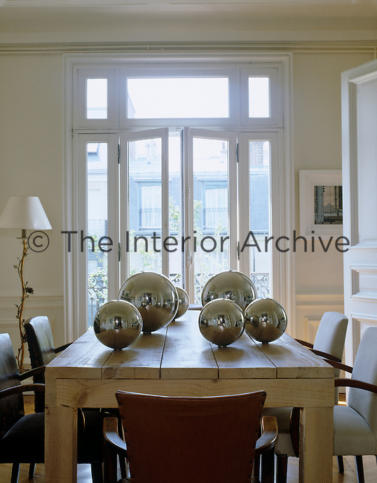 Metallic silver balls decorate the contemporary wooden dining table
