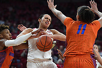 Arkansas' Chelsea Dungee draws a foul from Florida's Kiara Smith (left) Sunday Jan. 26, 2020 at Bud Walton Arena. Arkansas won 79-57 and play again on the road Thursday at Alabama. See nwaonline.com/uabball/ for a gallery of images from the game. (NWA Democrat-Gazette/J.T. Wampler)