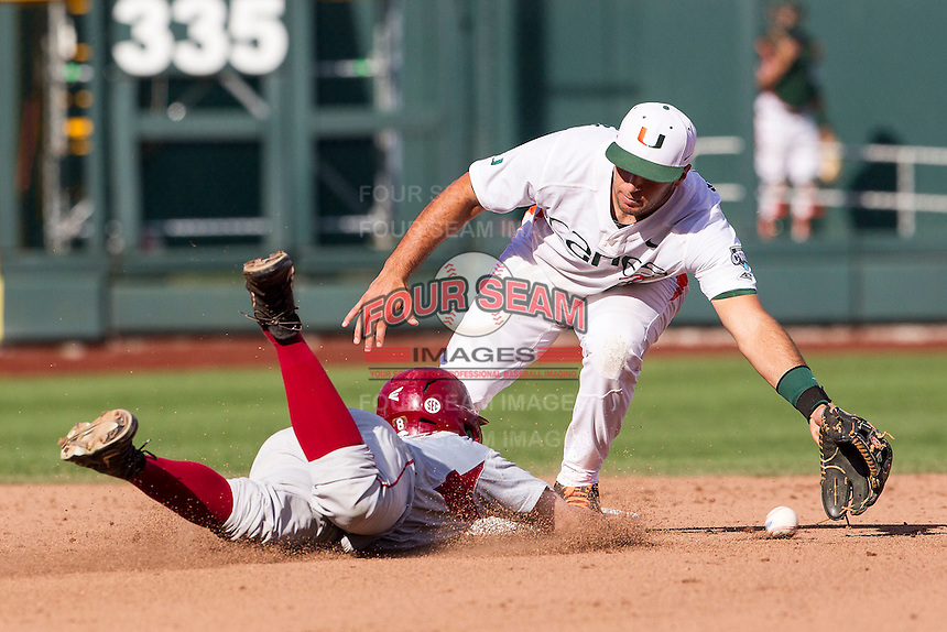 Miami Hurricanes second baseman George Iskenderian (7) reaches for the catchers throw at second base during the NCAA College baseball World Series against the Arkansas Razorbacks  on June 15, 2015 at TD Ameritrade Park in Omaha, Nebraska. Miami beat Arkansas 4-3. (Andrew Woolley/Four Seam Images)