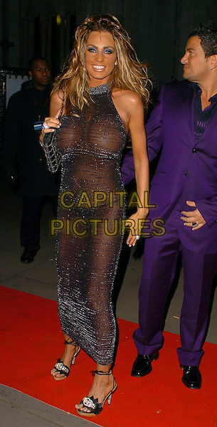 PETER ANDRE & KATIE PRICE (JORDAN).Andy Wong's Chinese New Year Party,.Royal Courts of Justice,.London, England, 28th January 2006..full length purple suit married husband wife sheer black silver see through dress boobs breasts nipples flashing knickers underwear .Ref: CAN.www.capitalpictures.com.sales@capitalpictures.com.©Capital Pictures