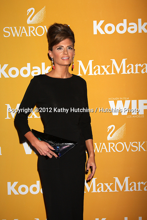 LOS ANGELES - JUN 12:  Stana Katic arrives at the City of Hope's Music And Entertainment Industry Group Honors Bob Pittman Event at Beverly Hilton Hotel on June 12, 2012 in Beverly Hills, CA