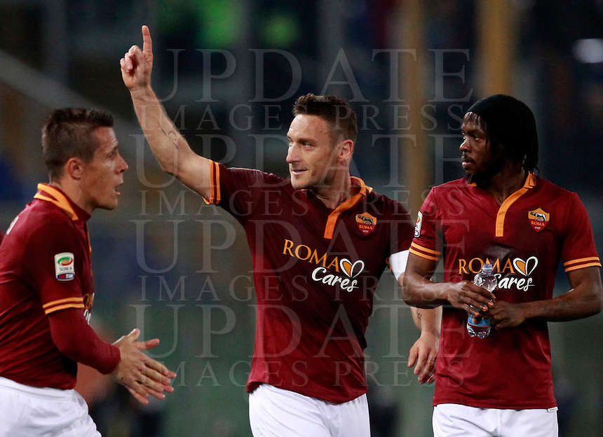 Calcio, Serie A: Roma vs Udinese. Roma, stadio Olimpico, 17 marzo 2014.<br /> AS Roma forward Francesco Totti, center, celebrates with teammates Rodrigo Taddei, of Brazil, left, and Gervinho, of Ivory Coast, after scoring during the Italian Serie A football match between AS Roma and Udinese at Rome's Olympic stadium, 17 March 2014.<br /> UPDATE IMAGES PRESS/Isabella Bonotto