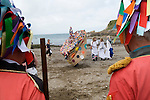 Hunting the Earl of Rone. Combe Martin Devon England. The Hobby Horse and women dancing on the beach. 2011