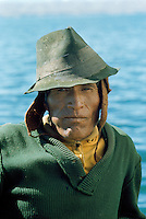 Aymara Indian fisherman chewing coca leaves swelling his cheek, Lake Titicaca, Bolivi