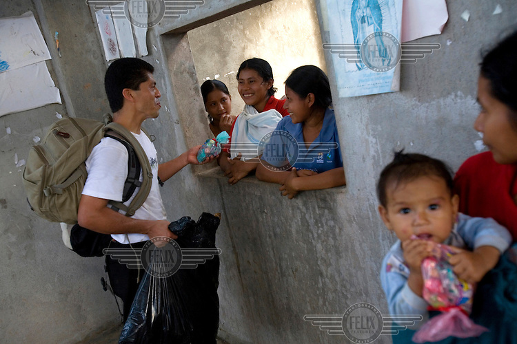 Pablo Fajardo talks to families in a Quichua pueblo called Shayari. He is the lead attorney for plaintiffs in a class action lawsuit brought against US multinational Texaco (acquired by Chevron in 2001) by more than 30,000 Ecuadorians. The case has been in the Ecuadorian courts since 2003 and relates to the dumping of billions of gallons of toxic materials into unlined pits and Amazonian rivers. In February 2011 the court ruled that Chevron should pay a fine totalling 9.5 billion USD. However, Chevron has stated that the ruling is 'illegitimate and unenforceable' and has started numerous counter proceedings in US courts. There is some doubt as to whether it will be possible to force Texaco to pay the fine.