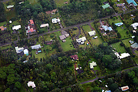 An aerial view of rural Kea'au houses seen from a helicopter tour over the Big Island.