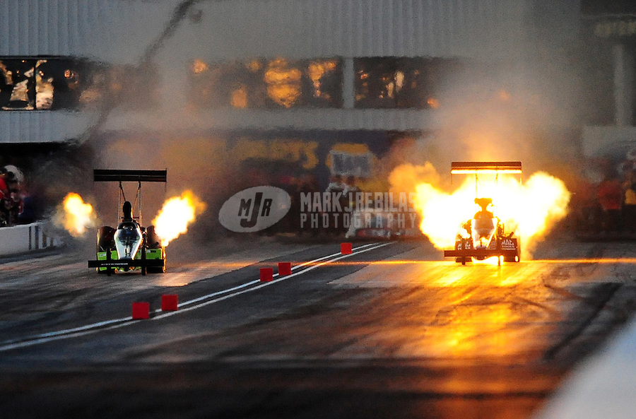 Feb. 19, 2010; Chandler, AZ, USA; NHRA top fuel dragster driver David Grubnic (right) explodes an engine alongside Steve Torrence during qualifying for the Arizona Nationals at Firebird International Raceway. Mandatory Credit: Mark J. Rebilas-