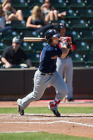 Nick Longhi (21) of the Salem Red Sox follows through on his swing against the Winston-Salem Dash at BB&T Ballpark on April 17, 2016 in Winston-Salem, North Carolina.  The Red Sox defeated the Dash 3-1.  (Brian Westerholt/Four Seam Images)