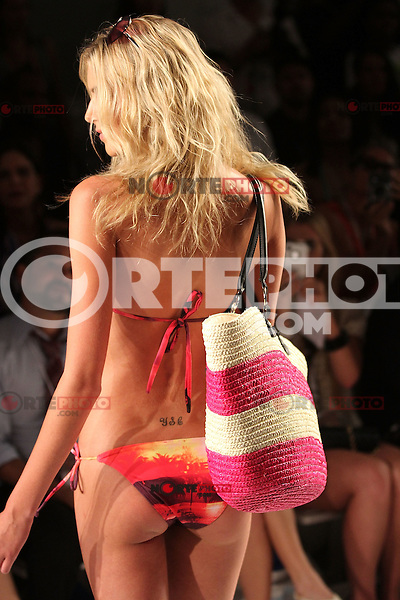 MIAMI BEACH, FL - JULY 14: A model walks the runway for Diesel during Mercedes-Benz Fashion Week Swim at The Raleigh on July 14, 2011 in Miami Beach, Florida. (photo by: MPI10/MediaPunch Inc.)