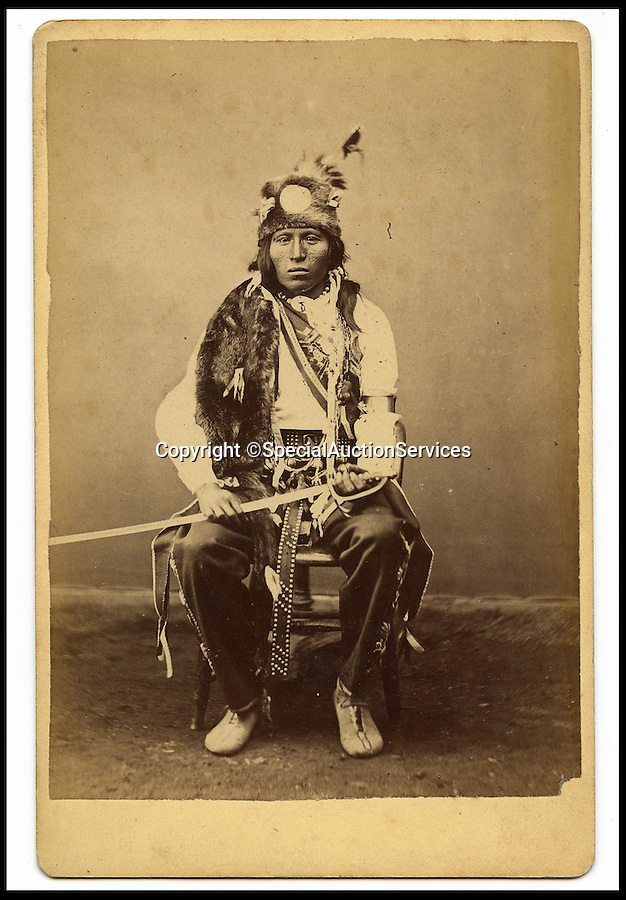 """BNPS.co.uk (01202 558833)<br /> Pic: SpecialAuctionServices/BNPS<br /> <br /> *Please use full byline*<br /> <br /> Lot 406-2.  Little Soldier, Cree Tribe.<br /> <br /> Poignant insight into a lost world...<br /> <br /> An important collection of Native American Images - including a portrait of the famous Sitting Bull - will be offered in the Photographica sale on Thursday 23rd October and is expected to fetch over £10,000.<br /> <br /> The photographs were collected by the vendor's great grandfather during his travels to America. He first journeyed to North America in 1862 to find out more about Native Indians and subsequently returned in 1866, 1874 and several times after that. The first three trips are described in a book that he wrote and published in 1890 entitled Sport and Adventures amongst the North American Indians.<br /> <br /> The collection comprises 127 images taken by pioneering photographers including American government photographer John Karl Hillers (1843- 1925) and explorer and painter William. H. Jackson. It contains portraits as well as scenes of family and working life that provide a real insight into everyday living in the 1870s – 1880s. Estimates for the group lots range from £100 to £5,000.<br /> <br /> The photographs were taken using the latest technology of the time; the invention of dry-plate made it possible for photographers to go into the wilds of native USA and document everyday life; and the use of traditional stereoscopic photography means the subjects in the portrait shots appear 3-Dimensional. <br /> <br /> Hugo Marsh, Head of Photographica says: """"This collection of photographs provides us with a greater understanding and a terrific insight into the lives of Native American Indians of the time. It is rare to see a large collection in such good condition."""""""