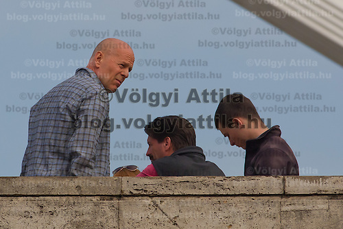 US actor Bruce Willis is seen with members of the cast during a shooting of the fifth piece in the Die Hard series titled Good Day to Die Hard during a shooting day in Budapest, Hungary on May 19, 2012. ATTILA VOLGYI