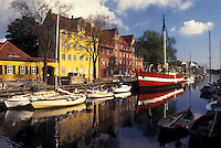 Copenhagen, Denmark, Scandinavia, Sjaelland, Europe, Boats and buildings along a canal in the scenic city of Copenhagen.