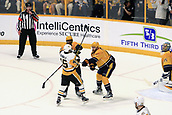 June 5th 2017, Nashiville, TN, USA;  Referee Kevin Pollock (33) looks on as Nashville Predators defenseman Mattias Ekholm (14) and Pittsburgh Penguins right wing Josh Archibald (45) battle for position during Game 4 of the Stanley Cup Final between the Nashville Predators and the Pittsburgh Penguins, held on June 5, 2017, at Bridgestone Arena in Nashville, Tennessee. Ekholm received a roughing and slashing penalty on the play. Archibald received a slashing penalty. Nashville Predators defenseman P.K. Subban (76) is also shown.