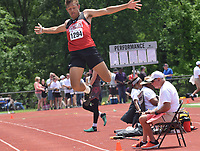 RICK PECK/SPECIAL TO MCDONALD COUNTY PRESS McDonald County's Michael Williams flies to a seventh place in the long jump with a leap of 21-5.25 at the Missouri Class 4 State Track and Field Championships held May  25 at Washington High School.