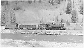 RGS 4-6-0 #20 pulling gondola and caboose between Montelores and King (south of Rico).<br /> RGS  between Montelores and King, CO  Taken by Richardson, Robert W. - 5/23/1951