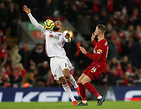 2nd January 2020; Anfield, Liverpool, Merseyside, England; English Premier League Football, Liverpool versus Sheffield United; David McGoldrick of Sheffield United controls the high ball as Jordan Henderson of Liverpool challenges - Strictly Editorial Use Only. No use with unauthorized audio, video, data, fixture lists, club/league logos or 'live' services. Online in-match use limited to 120 images, no video emulation. No use in betting, games or single club/league/player publications
