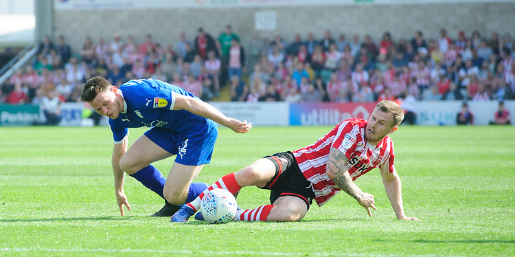 Tranmere Rovers' Connor Jennings is tackled by Lincoln City's Michael O'Connor<br /> <br /> Photographer Chris Vaughan/CameraSport<br /> <br /> The EFL Sky Bet League Two - Lincoln City v Tranmere Rovers - Monday 22nd April 2019 - Sincil Bank - Lincoln<br /> <br /> World Copyright © 2019 CameraSport. All rights reserved. 43 Linden Ave. Countesthorpe. Leicester. England. LE8 5PG - Tel: +44 (0) 116 277 4147 - admin@camerasport.com - www.camerasport.com