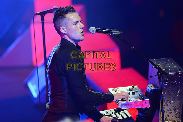 Brandon Flowers of 'The Killers' performing at V Festival, Hylands Park, Chelmsford, Essex, England..19th August 2012.on stage in concert live gig performance music half length black shirt singing side profile keyboards .CAP/MAR.© Martin Harris/Capital Pictures.