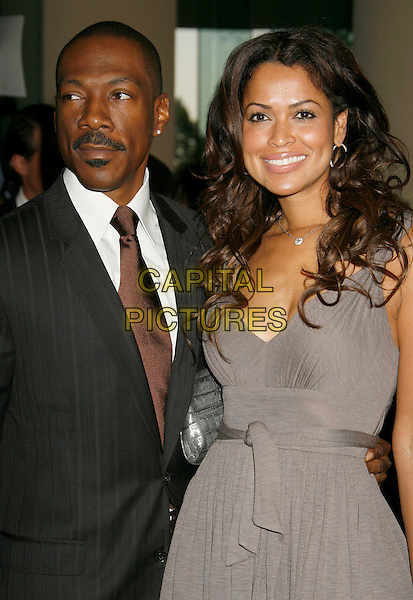 EDDIE MURPHY & TRACEY EDMONDS.79th Annual Academy Awards Nominees Luncheon held at the Beverly Hilton Hotel, Beverly Hills, California, USA..February 5th, 2007.half length black suit jacket grey gray dress Tracy couple .CAP/ADM/RE.©Russ Elliot/AdMedia/Capital Pictures