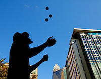A silhouetted juggler performs during the Wells Fargo Community Celebration, held October 29, 2011 in downtown Charlotte NC. The daylong festival took place in the streets, in public atriums and in downtown museums, which offered free admission all day long. Wells Fargo, which this month completed its conversion from Wachovia, picked up the bill.