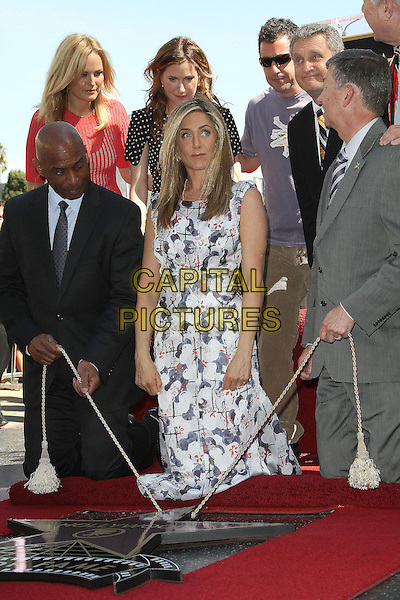 Malin Ackerman, Jennifer Aniston, Kathryn Hahn and Adam Sandler.Jennifer Aniston is honored with a Star on the Hollywood Walk of Fame on Hollywood Blvd., Hollywood, California, USA..February 22nd, 2012.full length white blue print dress grey gray suit black kneeling rope .CAP/ADM/KB.©Kevan Brooks/AdMedia/Capital Pictures.