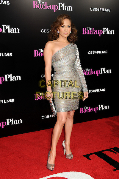 "JENNIFER LOPEZ .""The Back-up Plan"" Los Angeles Premiere held at the Regency Village Theatre, Westwood, California, USA, 21st April 2010..arrivals full length sleeve one shoulder silver  sheer shimmery shiny dress clutch bag peep toe shoes beige .CAP/ADM/BP.©Byron Purvis/AdMedia/Capital Pictures."