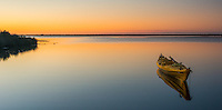 Sunset scene with kayak in Okarito Lagoon, Westland Tai Poutini National Park, West Coast, UNESCO World Heritage Area, South Westland, New Zealand, NZ