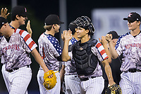 Kannapolis Intimidators catcher Seby Zavala (21) high fives his teammates following their win over the Hickory Crawdads in game two of a double-header at Kannapolis Intimidators Stadium on May 19, 2017 in Kannapolis, North Carolina.  The Intimidators defeated the Crawdads 9-1.  (Brian Westerholt/Four Seam Images)