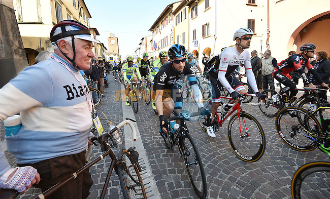 The riders roll out pass a vintage cyclist for the start of Stage 3 of the 2015 Tirreno-Adriatico cycle race running 203km from Càscina to Arezzo, Italy. 13th March 2015. Photo: ANSA/Daniel Dal Zennaro/www.newsfile.ie