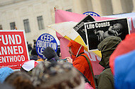 January 23, 2012  (Washington, DC)  Both Pro-life and pro-choice supporters hold signs in front of the U.S. Supreme Court during the annual March For Life and rally in Washington.   (Photo by Don Baxter/Media Images International)