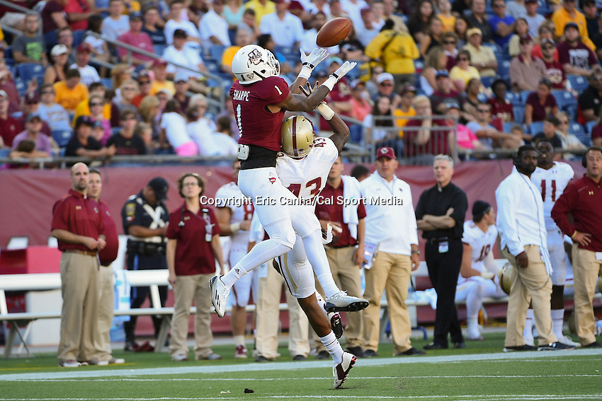 August 30, 2014 - Foxborough, Massachusetts, U.S. - Massachusetts Minutemen wide receiver Tajae Sharpe (1) and Boston College Eagles cornerback John Johnson (43) battle for the ball during the NCAA Division I football game between Boston College Eagles and the University of Massachusetts Minutemen held at Gillette Stadium in Foxborough Massachusetts.  Boston College defeated The Minutemen 30-7. Eric Canha/CSM